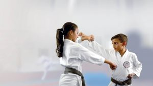 GKR Karate Self defence, boy punching, girl blocking