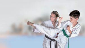 GKR Karate, Sensei, Instructor, helping student, Karate Kick