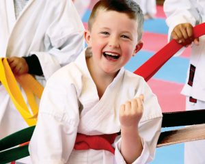 happy red belt karate student laughing