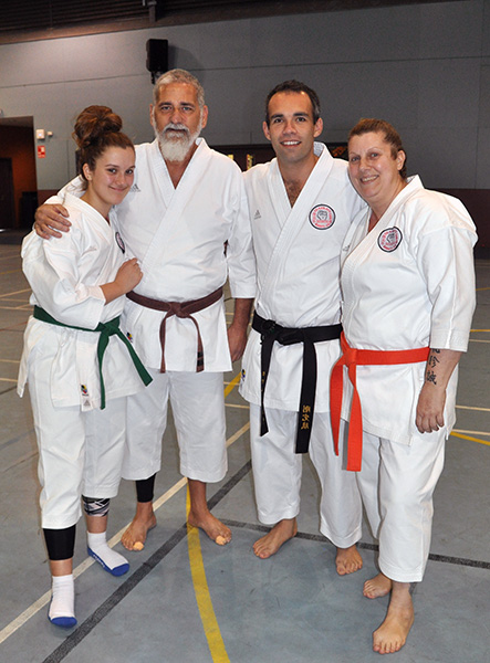 In cherished company: Bill Terry is flanked by his extended family – Patience (left), Sensei Rowan Cassidy and Zita